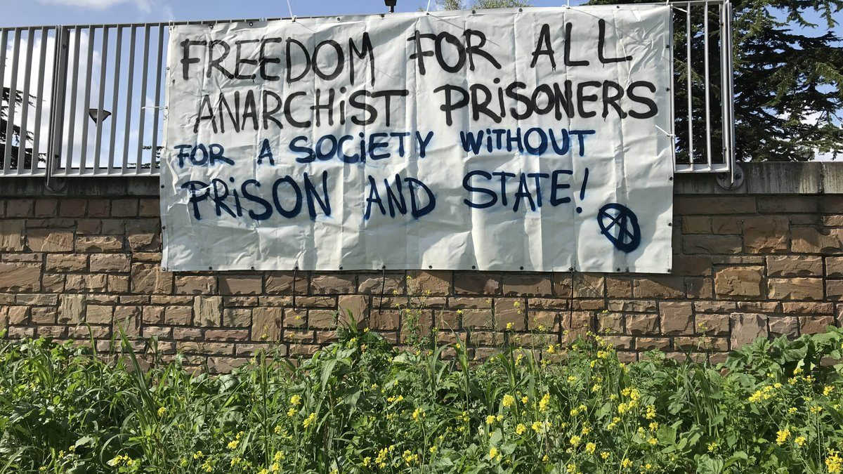August 30th in Haag, Netherlands: Banners in solidarity with anarchist prisoners